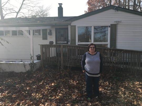 Diana Bandak outside of her Newark home