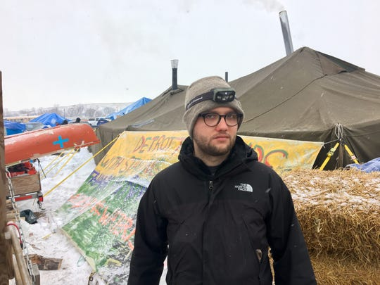 Jacob Brooks, 23, of Ann Arbor left his job to live at the Oceti Sakowin resistance camp in opposition to the Dakota Access oil pipeline. He spoke with the Free Press on Dec. 5, 2016 at a camp where Michiganders have come together.