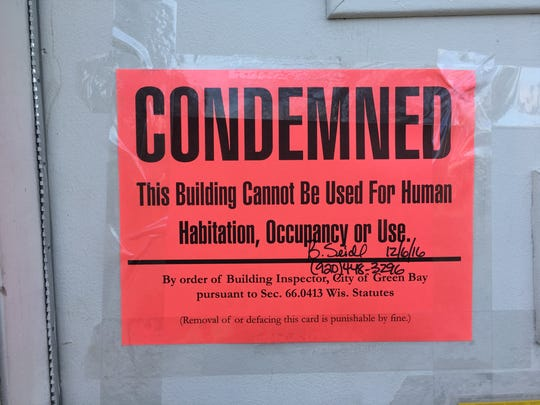 The placard displayed by the Brown County Health Department at single family home in the 1000 block of Shawano Avenue for dangerous levels of mercury.
