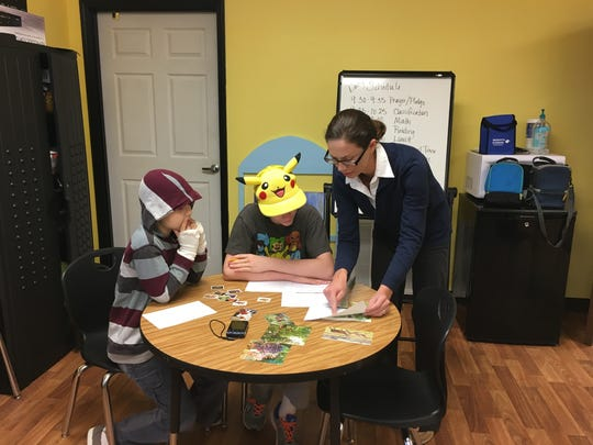 Founder Jessica Fulton offers guidance to Travis Walston and Brennan Hayes during a lesson on classification at the Independent School of Thought in Hernando.