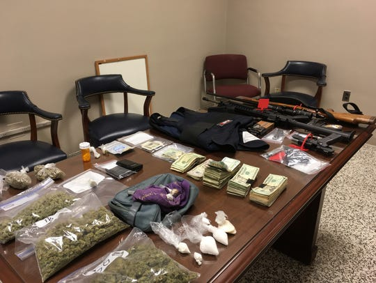 Drugs, guns and cash seized during a raid on Letcher