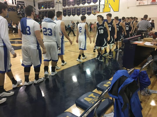 The Marysville and Croswell-Lexington boys basketball teams shake hands after the Vikings victory Friday at the Ed Peltz Holiday Tournament at Port Huron Northern High School.