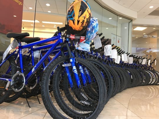 Donated bicycles wait to be loaded onto a Toys for