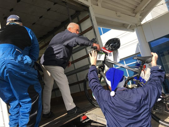 Hyundai workers in Montgomery help load bicycles into