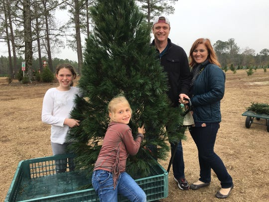 The Dozier family after picking a Christmas tree from