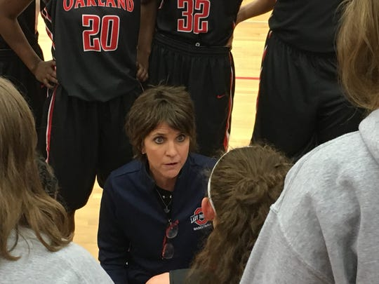 Oakland coach Jennifer Grandstaff talks to players during a 2016 game. The Lady Patriots forfeited 18 regular-season games.