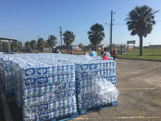 A shipment of water awaits residents in Zone 3, which remains in a ban against using tap water. The water was being distributed at the Lindale Senior Center on Dec. 17.