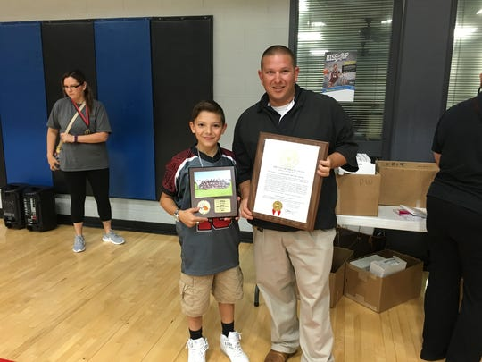 Chris Gutierrez and his son Michael celebrate the city�s proclamation of Nov. 22 as �Chris Gutierrez Day�