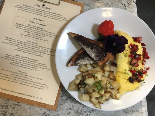 Breakfast options at Wicked's Brew in Ventura include an omelet with Black Forest ham, red bell peppers and white cheddar cheese, served with potatoes, marble rye, fruit and an edible flower.