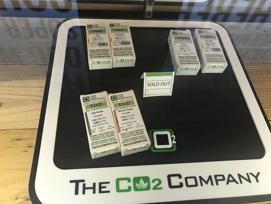 """A """"sold out"""" sign sits among CO2 marijuana products"""