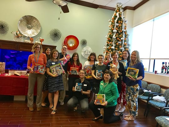 : FPRA Treasure Coast Chapter members collect toys for Guardians for New Futures at their December meeting