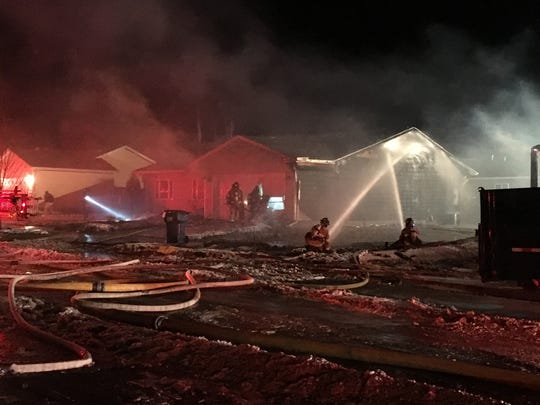 Fire crews battle a blaze in the 1500 block of 28th Avenue South on Tuesday night.