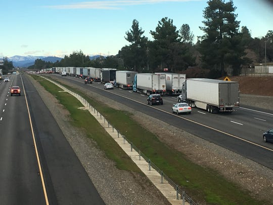 Traffic is backed up Wednesday afternoon on northbound Interstate 5 after the freeway reopened to semi-truck traffic.