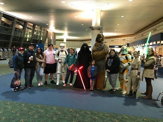 Joshua Beckett dresses up as Chewbacca to give a young girl a 3 a.m. send off at the Portland International Airport in December, 2016. The Jedi on the far left is Marnie Rae Freilinger, a second grade teacher at Lyle Elementary in Dallas.