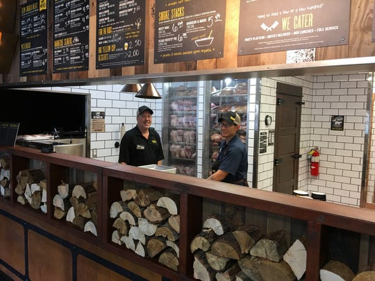 Dickeys manager Bruce Begeman, left, and pit master Bo Mancha prepare for the grand opening rush.