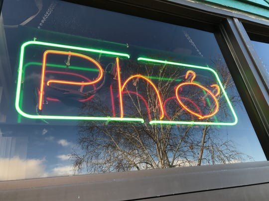 The neon sign outside  Pho Little Saigon in Fort Collins
