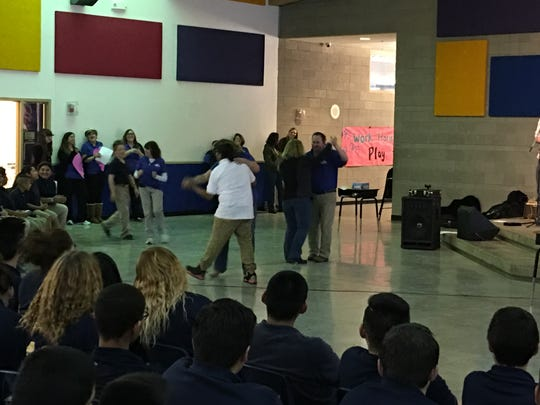 RMS 8th grader Lavern James, in white shirt, took a dare and asked a teacher to dance during Friday's anti-bullying assembly. Others soon followed.