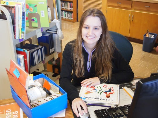 In this file photo, Silver Lake College student Victoria Bond of Manitowoc works in the college library as part of the SLC Works initiative.
