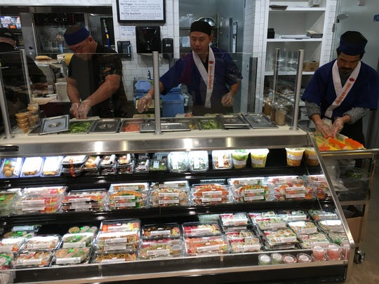 Sushi chefs prepare fresh rolls to go at the new delicatessen inside Westridge Midtown Market in Ojai.