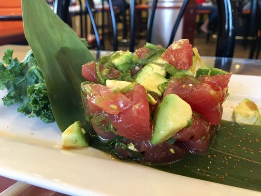 Tuna poke with avocado and seaweed salad from Yellowfin Sushi in Cape Coral.