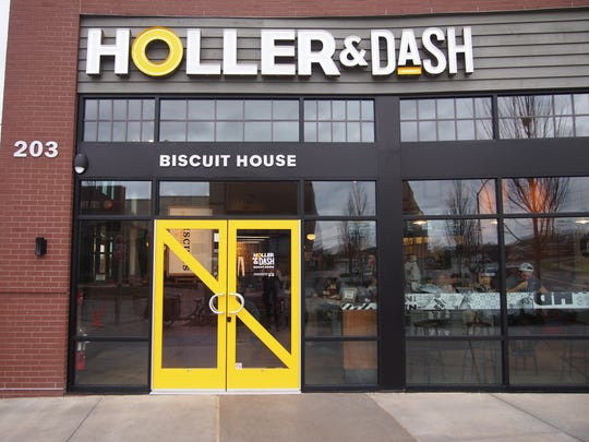 The bright yellow front door welcomes you to Holler & Dash.