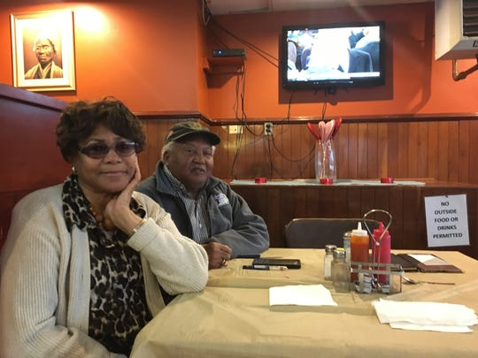 Gloria Edwards-Nutter on Friday watched the presidential inauguration at Evelyn's Soulfood in Wilmington. She said Americans need to strive for unity.
