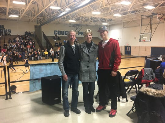 Gregg Wagner, his wife Lana and son Brett pose at Central Middle School during a benefit game held for Lana.