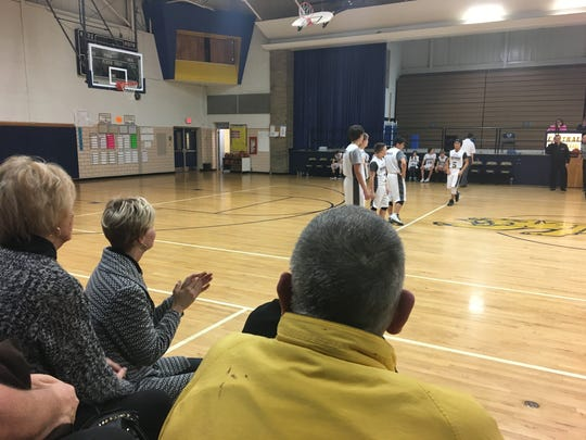 Lana Wagner watches from the stands at Central Middle School as players are introduced during a benefit game held in her honor.