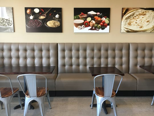 Decor at CINQO in Thousand Oaks includes banquette seating and photographs of ingredients used in Mexican cuisine.