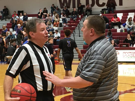 Mike Ruckman, Sr. talks with Warren County boys basketball