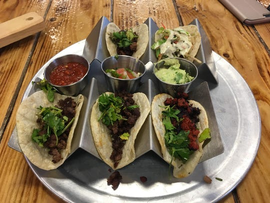 One Stop Kitchen & Bar offers $1 tacos on Taco Tuesday. Taco filling options include chicken, carne asada and al pastor.