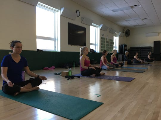 Julie Gissel, Danielle Kasten, Deb Maccagnano, Jamy Klopotic, Joanne Knoeck, Lorraine Henkelman and Paula Babiarz meditate during a class at the Greenheck Field House in Weston.