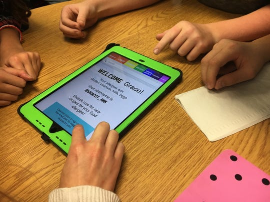 Five students in Shanan Riegle's language arts class discuss their winning app concept. The students won $5,000 for Yorktown Middle School