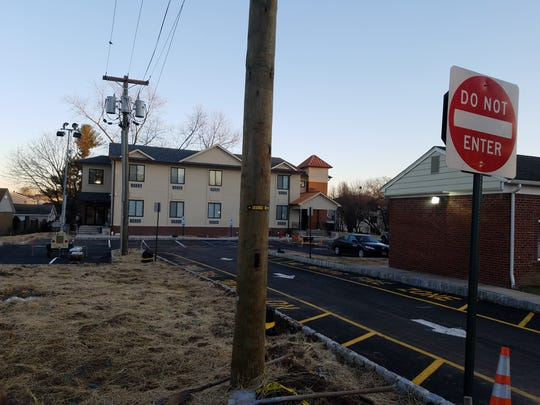 Residents whose homes are adjacent to this dormitory set back from Main Avenue have complained about loud music and are concerned about potential quality of life issues that could arise should the planning board approve a proposed expansion.