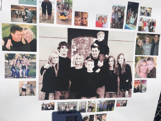 Photos of the Arnett family are posted at a fundraiser