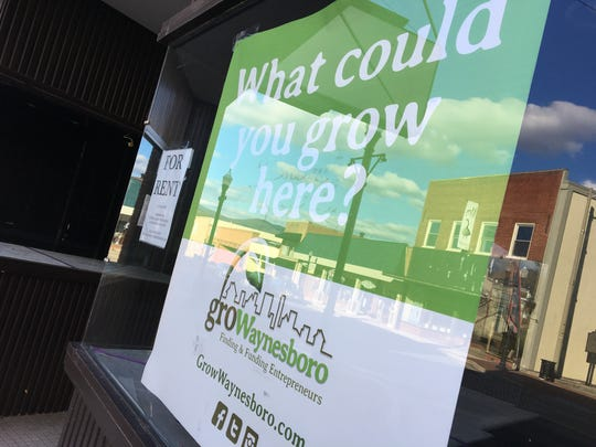 A Grow Waynesboro sign hangs in an empty storefront in downtown Waynesboro. The city is seeing 10 empty stores and is trying to fill them with new businesses.