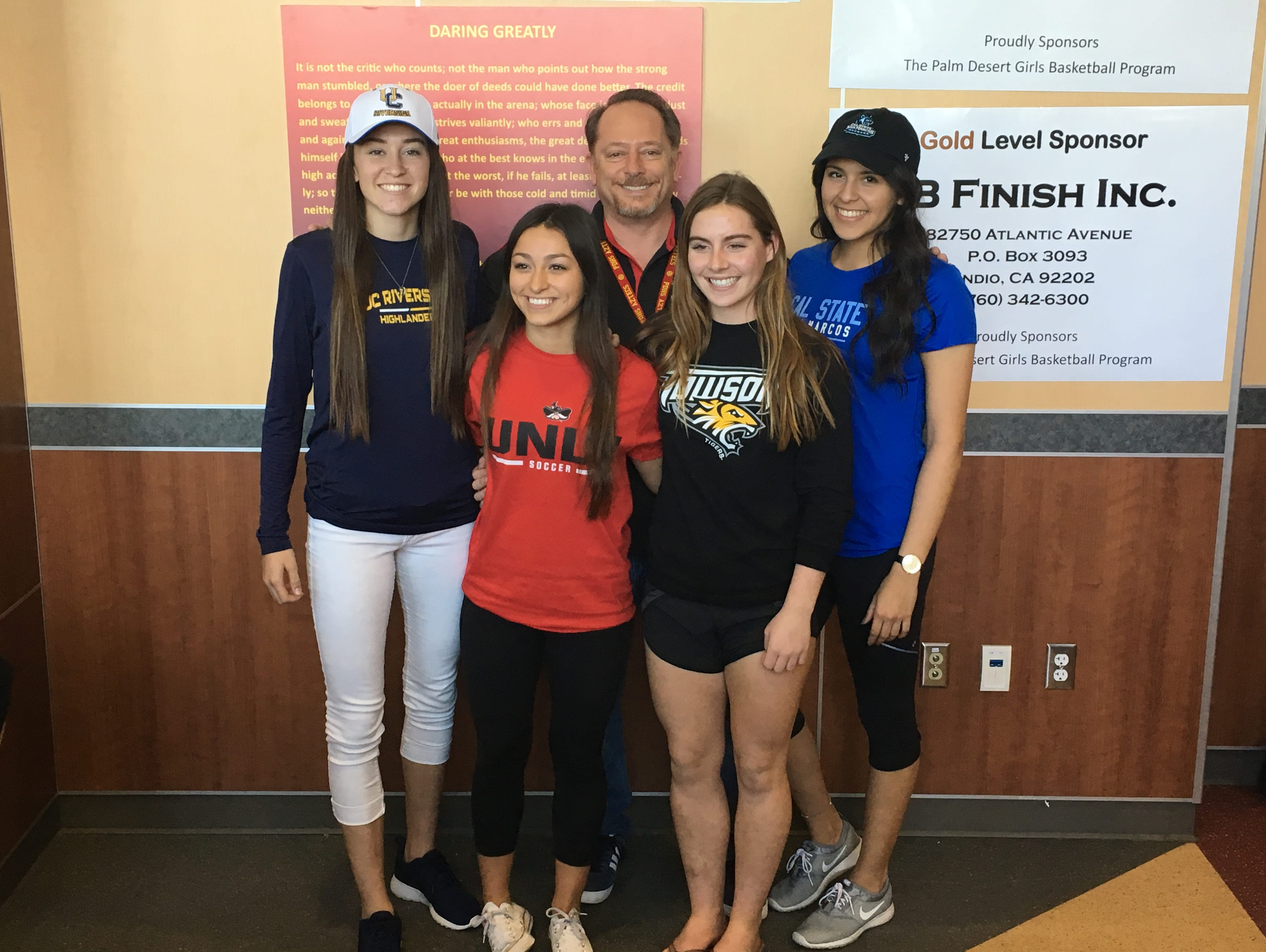 It was a great day for Palm Desert girls' soccer, as four players from the team signed their Letter of National Intent to play in college. Standing around coach Chris Keuilian are from left: Jane Jordan (UC Riverside), Alyssa Granados (UNLV), Afton Kalkoske (Towson), Alexandra Fabela (Cal State University San Marcos).