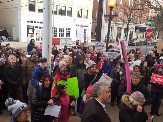 Hundreds gathered outside the Historic Courthouse in