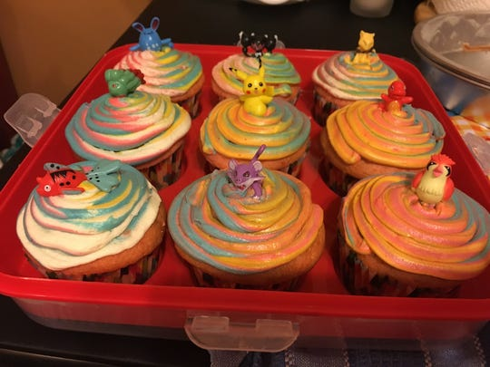For the rainbow frosting, Courtney used a sandwich bag. She made three colors of frosting and put scoops in the bag towards one bottom corner, then cut the tip and used it like a pastry bag to swirl the colors on the cupcakes.