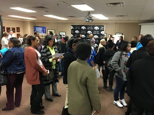 Parents and students gather in the board room of the Jackson-Madison County School Board for an information session on open enrollment in a file photo from two years ago. Through open enrollment, students can apply to attend schools they aren't zoned for.