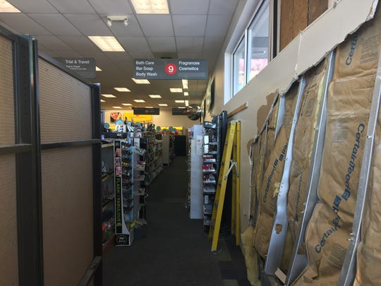 Four aisles of the Lincoln Ave. CVS are closed off to customers.