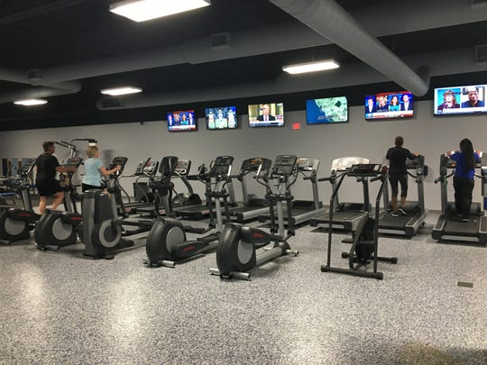 Lee County school employees have access to a recently expanded gym, fitness classes, health screenings, and group sessions that offer help about health, nutrition and finances.