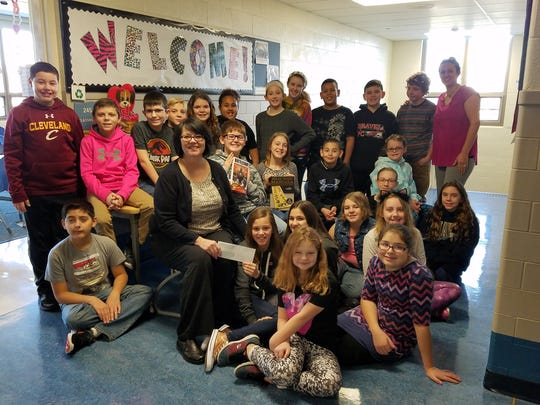 Teacher Melissa Frisch's 5th grade class won the 'Penny Challenge' for the Intermediate School.