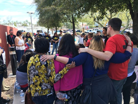 Supporters of Guadalupe Garcia de Rayos comfort each other after learning she would be deported by the U.S. Immigration and Customs Enforcement in Phoenix on Feb. 8, 2017.