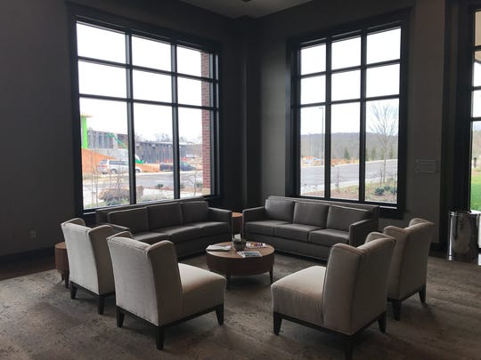 The Venue at Lenoir City includes a Fireside Concourse. Visible through the window is construction of the city utility board's operations center.