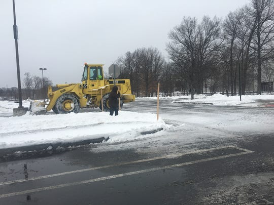 Plows hard at work at the mostly deserted parking lots at Westfield Garden State Plaza in Paramus.