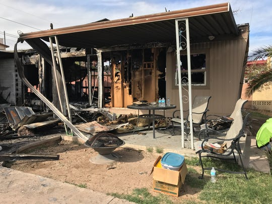 Burnt-out remains of a mobile home in Phoenix after