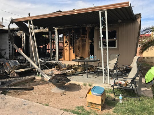 Burnt-out remains of a mobile home in Phoenix after a gas explosion started a massive fire.