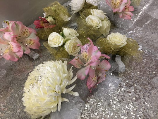 """A table is laden with corsages and boutonnieres at the 2017 """"Night to Shine"""" event held at the Cornerstone Church of Augusta County on Friday night."""