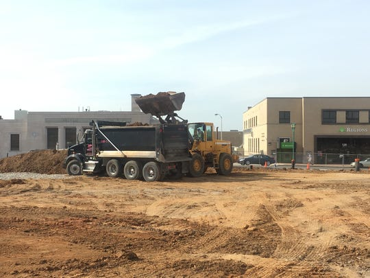 Ground-level view of site work at civic plaza